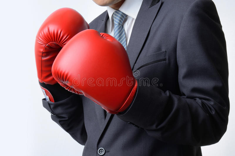 businessman with boxing glove ready to fight with problem, business concept stock photography