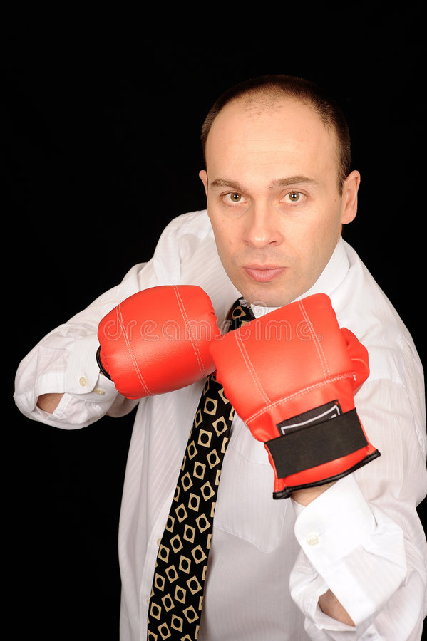 Businessman with boxing gloves royalty free stock photos