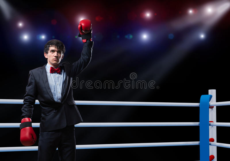 Businessman with boxing gloves in the ring royalty free stock photo