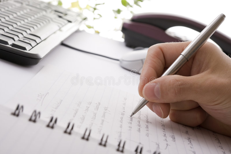 Businessman brainstorming and writing notes royalty free stock images