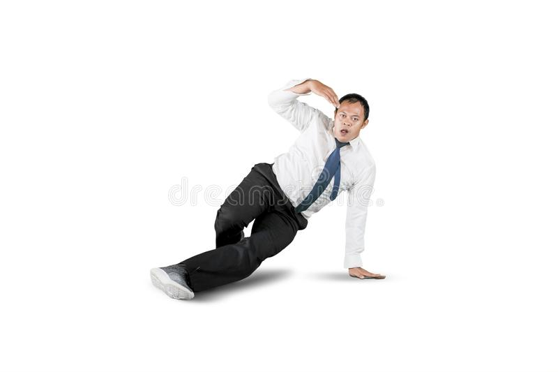 Businessman with break dancing move isolated over white royalty free stock image