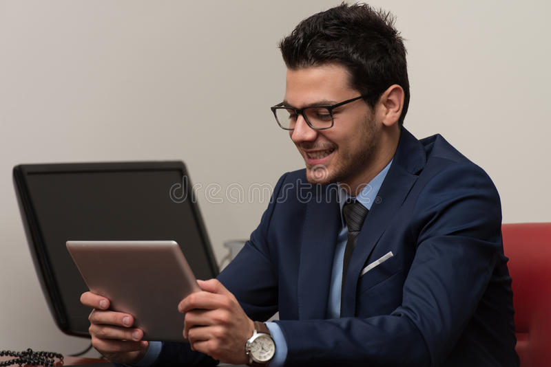 Download Businessman On A Break With His Touchpad Stock Image - Image: 43253337
