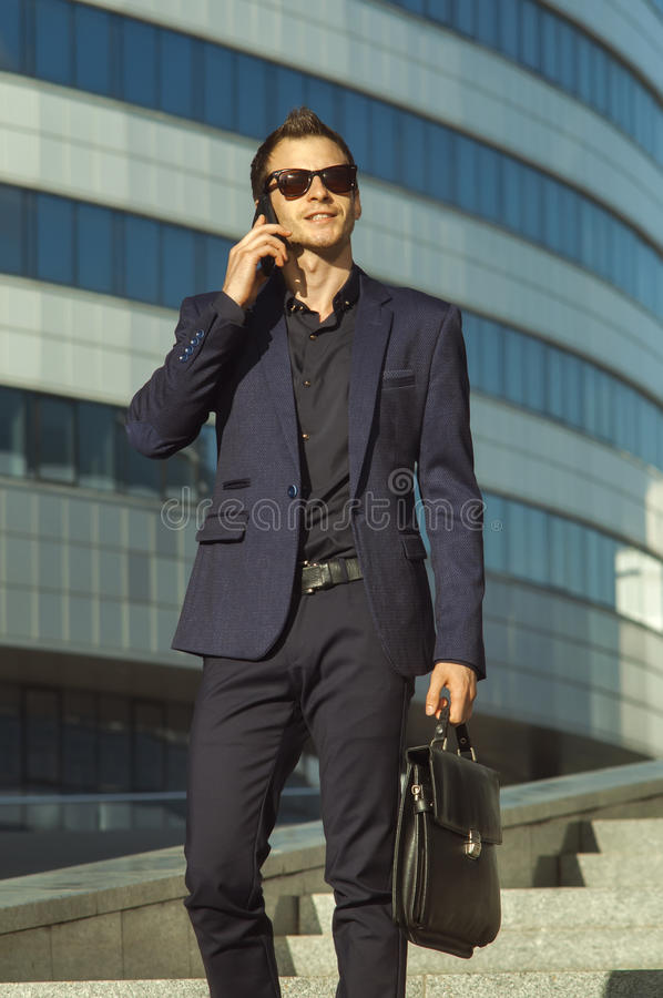 Businessman with briefcase in a glasses stock photo