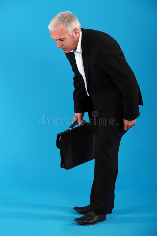 Businessman with briefcase royalty free stock photo