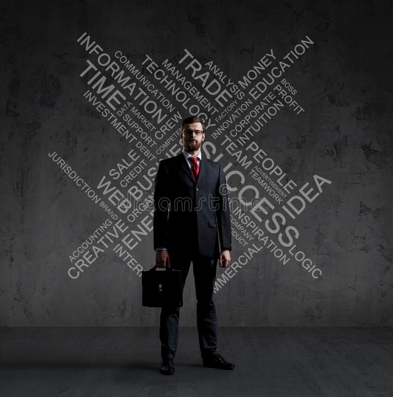 Businessman with briefcase standing over wall with text. Business, success, improvement, concept. stock photo