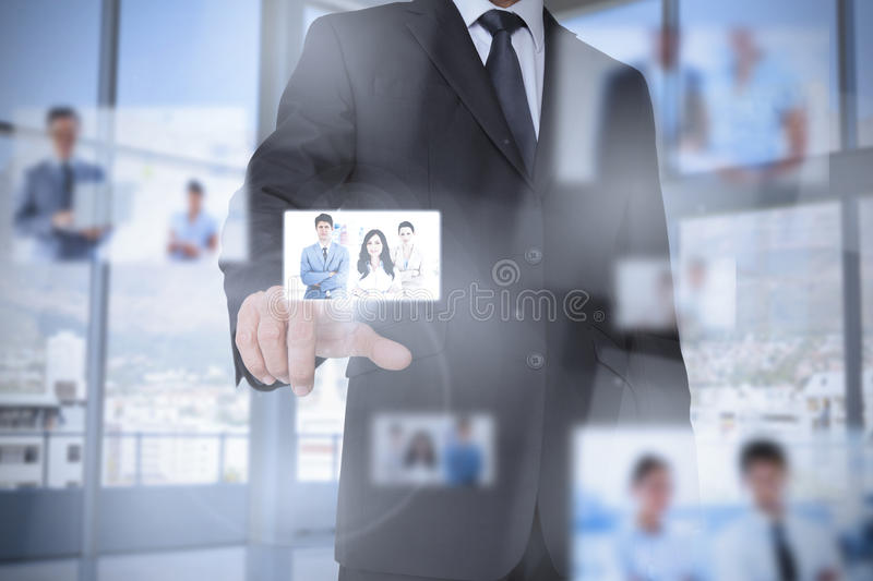 Businessman in bright office presenting digital interface stock images