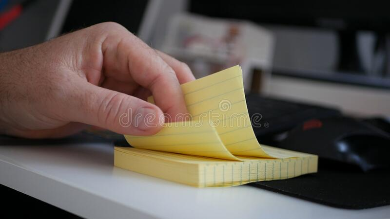 Businessman Browsing Small and Yellow Sticky Notes on Office Desk.  stock photo