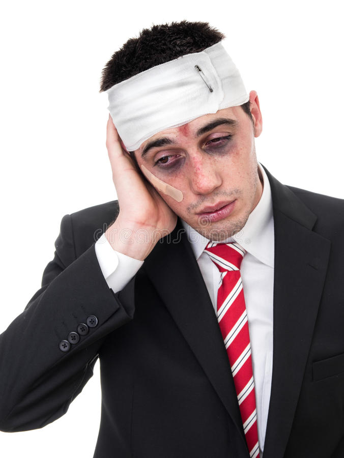 Businessman with bruised eyes and head