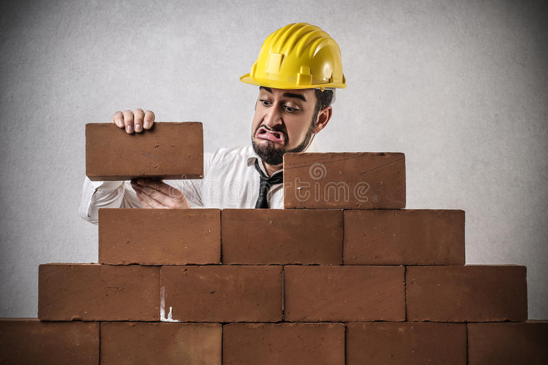 Businessman building a wall stock photo