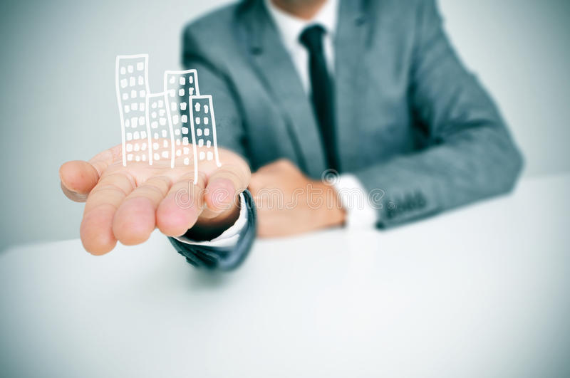 Businessman and buildings stock images
