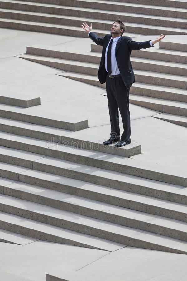 Businessman Business Man Arms Outstretched on Steps stock images