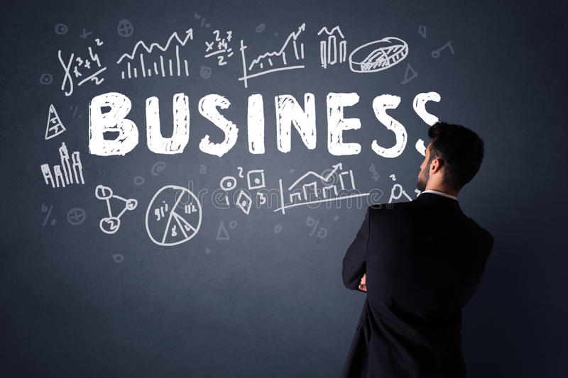 Businessman with business plan stock photography