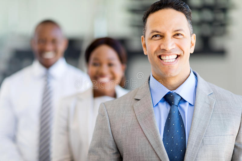 Businessman with business team. Handsome businessman with business team on background stock images