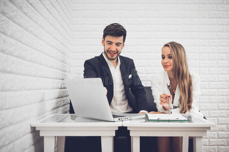 Businessman and business woman analyzing income charts and graph stock image