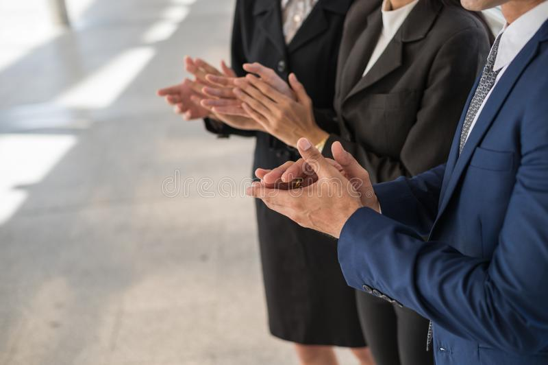 Businessman and business woman clap their hands to congratulate the signing of an agreement or contract between their companies. Businessman and business woman royalty free stock photos
