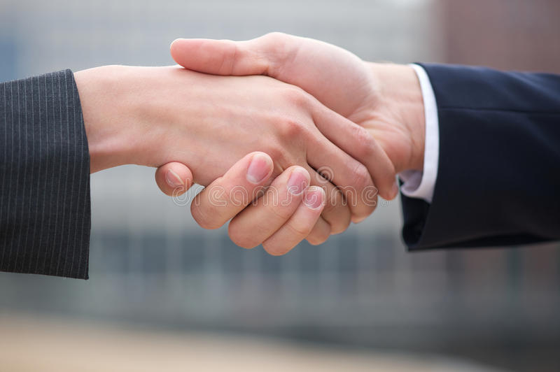 Businessman and business woman handshake royalty free stock photo