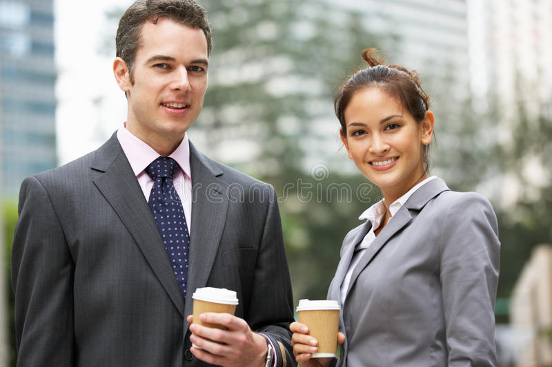 Download Businessman And Businesswoman Chatting In Street Stock Image - Image: 26094373