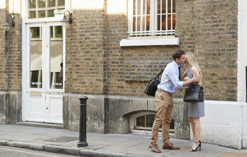 Businessman And Businesswoman Greeting Each Other On Street stock image
