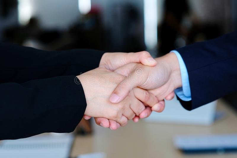 Businessman and businesswoman handshake at partnership corporate meeting, Close up of business corperate partnership handshake at stock photo