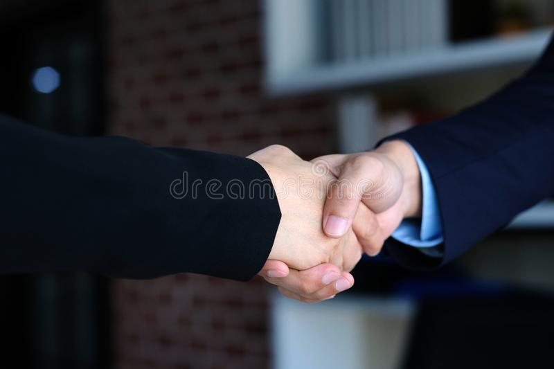 Businessman and businesswoman handshake at partnership corporate meeting, Close up of business corperate partnership handshake at stock photography