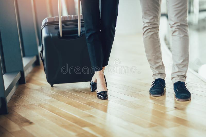 Businessman and businesswoman hold luggage travel to business trip stock images