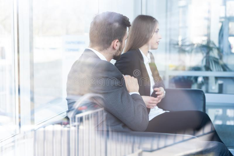 Businessman And Businesswoman Meeting In Modern Office. stock photo