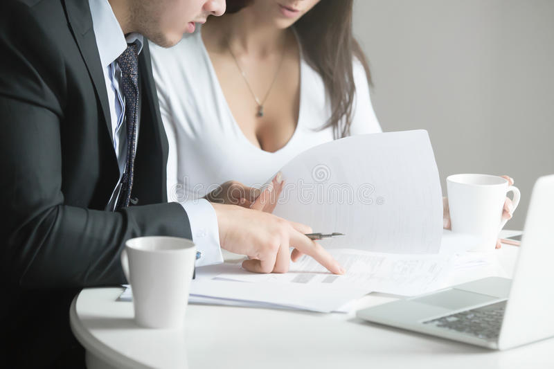 Businessman and businesswoman at office desk, working together w stock photos