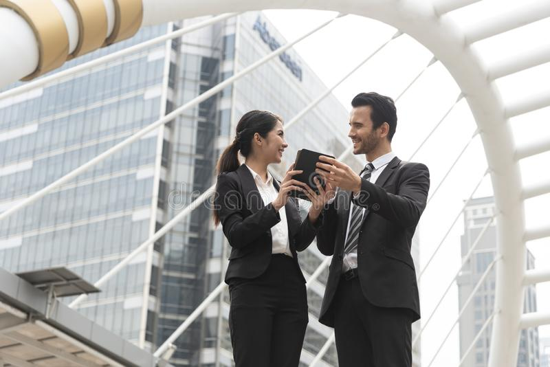 Businessman and businesswoman partner consulting and discussing at outdoor royalty free stock image