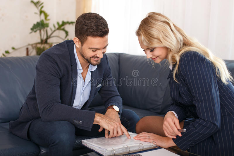 Businessman and businesswoman review contract stock photo