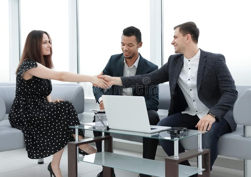 Businessman and businesswoman shaking hands at a business meeting royalty free stock images