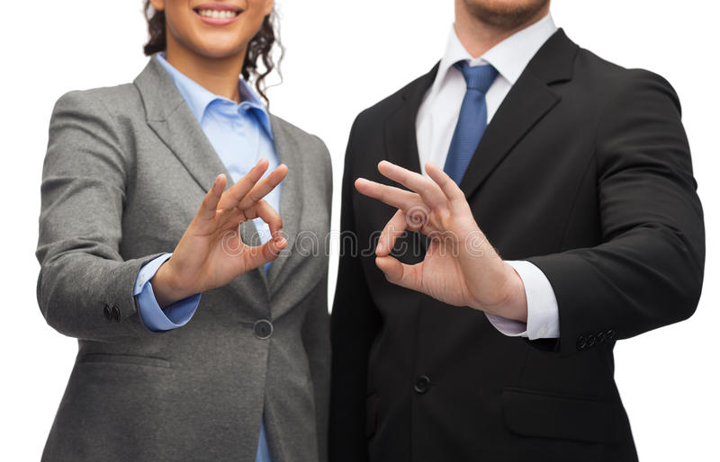 Businessman and businesswoman showing ok sign royalty free stock images