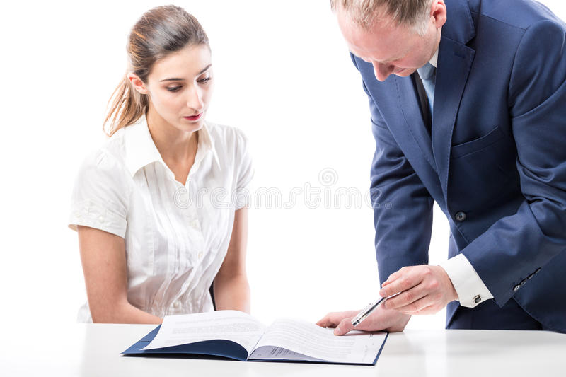 Businessman and businesswoman signing a papers. Businessman and businesswoman signing a documents on white background stock images