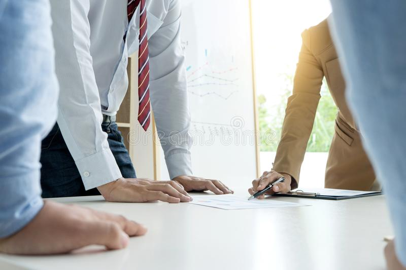 businessman and businesswoman stand all hand on table in business discussion royalty free stock photos