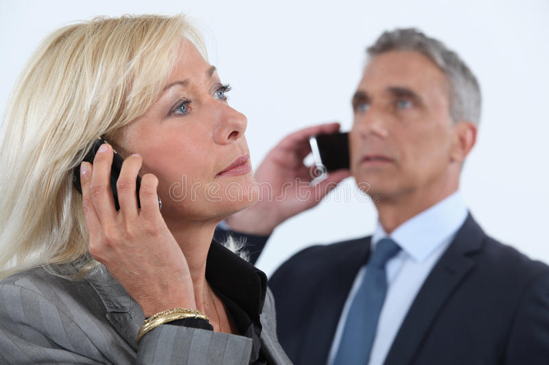 Businessman and businesswoman talking stock photos