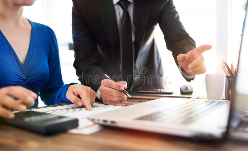 Businessman And Businesswoman Working In Office Together In Coop stock photo