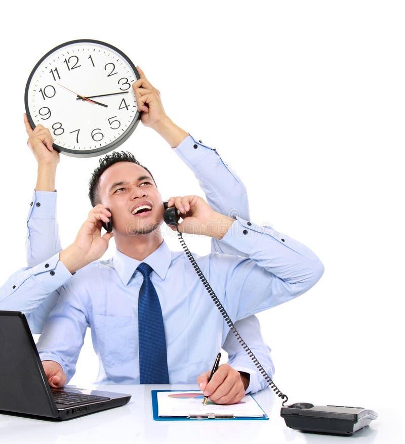 Businessman busy multitasking stock image