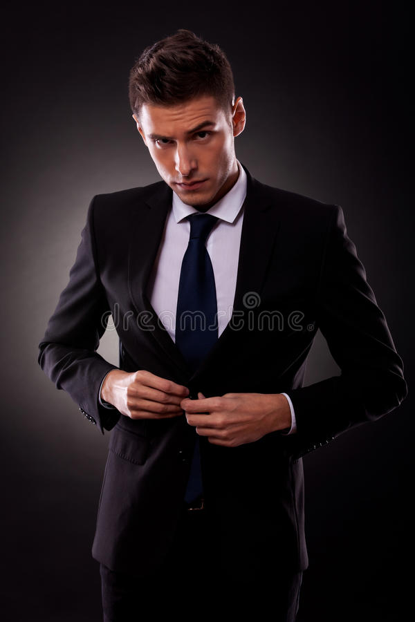 Businessman buttoning jacket, getting dressed stock image