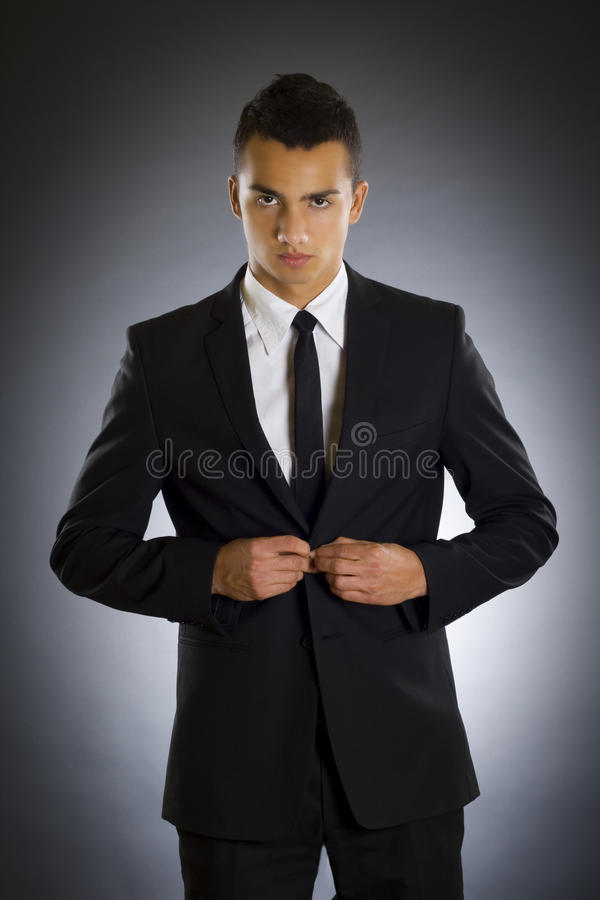 Businessman buttons up the suit stock images