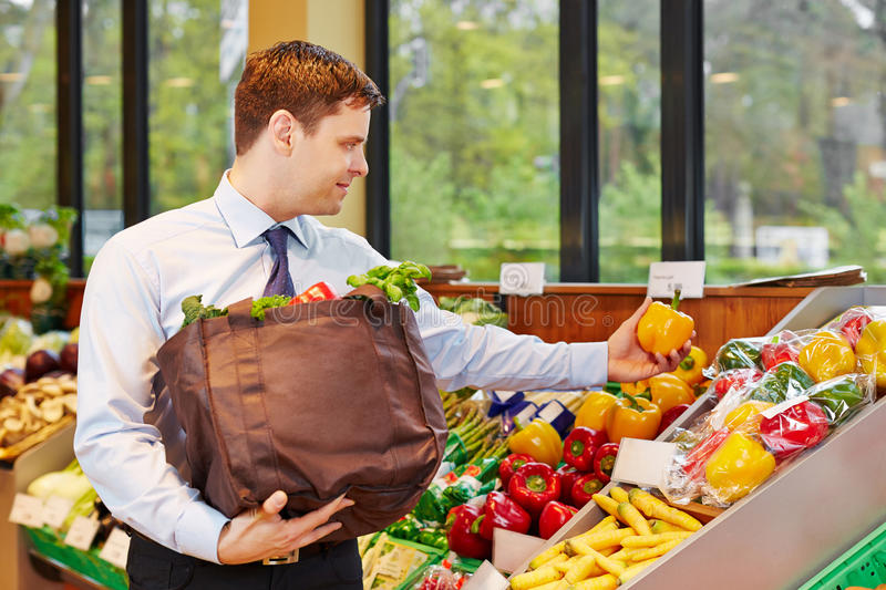 Businessman buying vegetables royalty free stock images