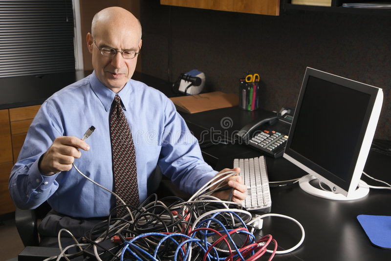 Businessman with cables royalty free stock images