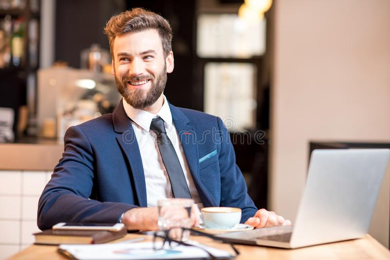 Businessman at the cafe royalty free stock photography