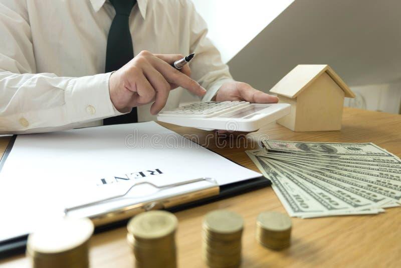 Businessman calculates buy - sale price house . Agent sale home. Insurance. business concept stock photos