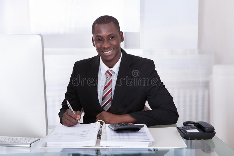 Businessman calculating finance royalty free stock images