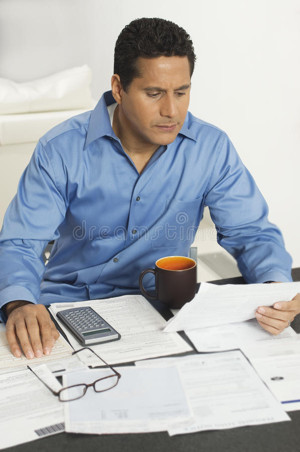 Businessman Calculating Financial Budget stock images