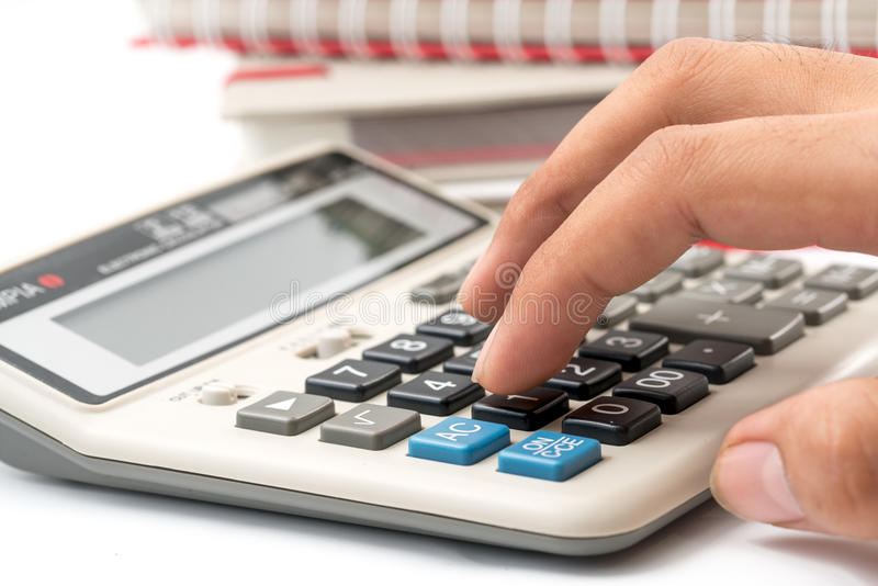 Businessman is calculating and working, a lot of documentation i stock photography