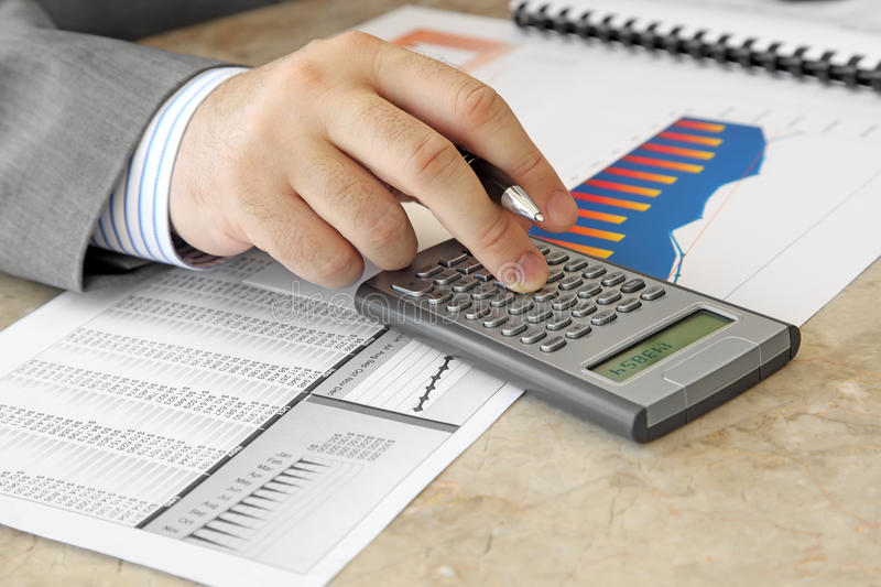 Download Businessman With Calculator Stock Photo - Image: 26612006