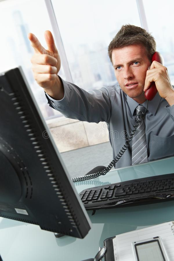 Download Businessman Calling And Gesturing In Office Stock Photo - Image of alone, career: 13242284