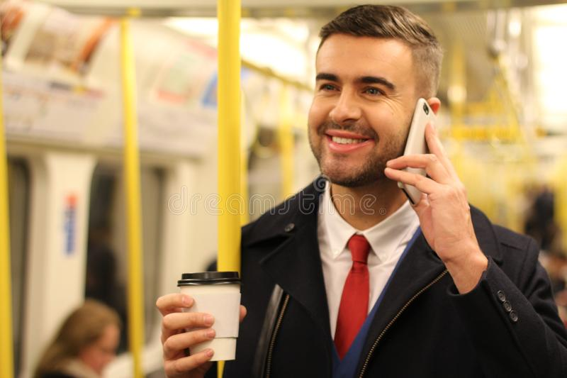 Businessman calling by phone while commuting royalty free stock photos