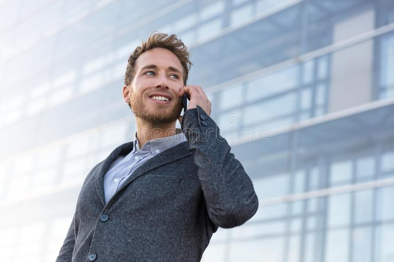 Businessman calling talking on the phone having business conversation stock image