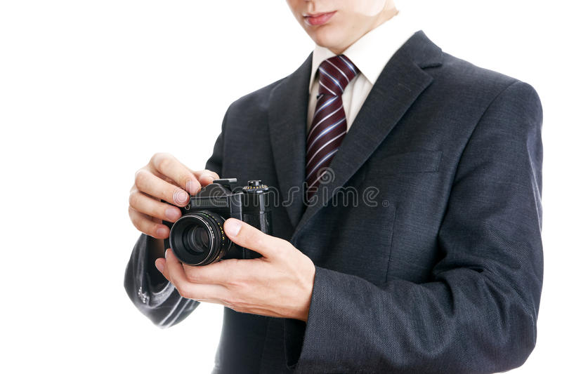 Businessman with camera stock images